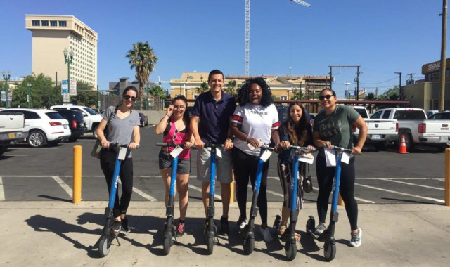 Family Medicine team posing with scooters in down town El Paso.