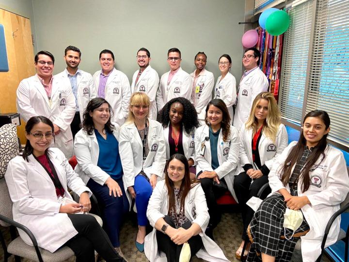 Residents group photo in white coats.