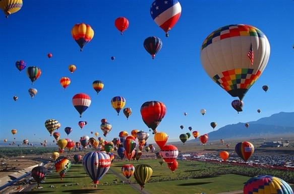 Many hot air balloons at the El Paso balloonfest.