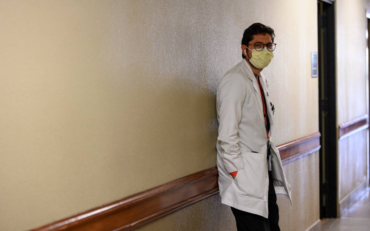 A physician with a face mask stands in the hallway of a Texas Tech Physicians of El Paso clinic.