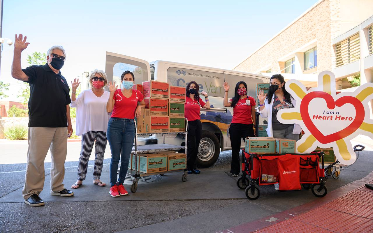 El Paso Children's Hospital officials, Bruce and Jackie Gulbas, and Andrea Tawney, Ph.D., outside El Paso Children's Hospital with boxes of donated Girl Scouts cookies.