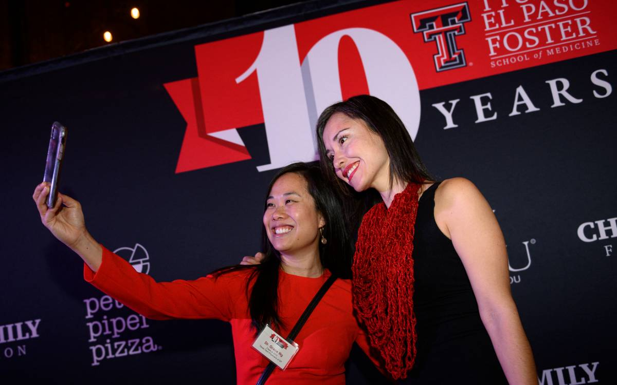 Two women taking a selfie at the Foster School of Medicine's 10-year anniversary celebration event.