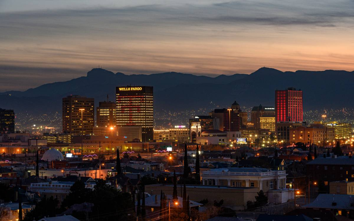The Wells Fargo building lit with Double T's, and One San Jacinto Plaza lit in red in Downtown El Paso.